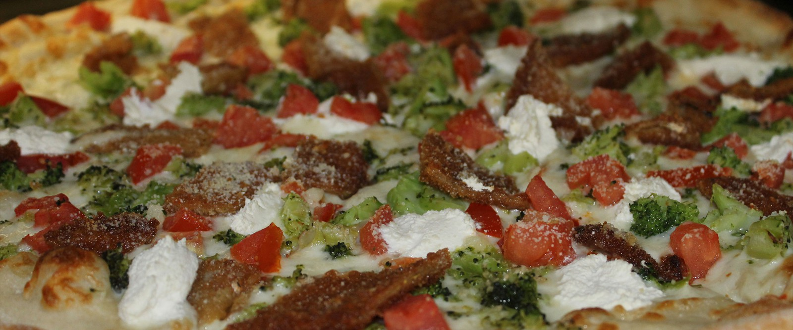 Try One Of Our Gourmet Pizzas. Boun Appetito!!
